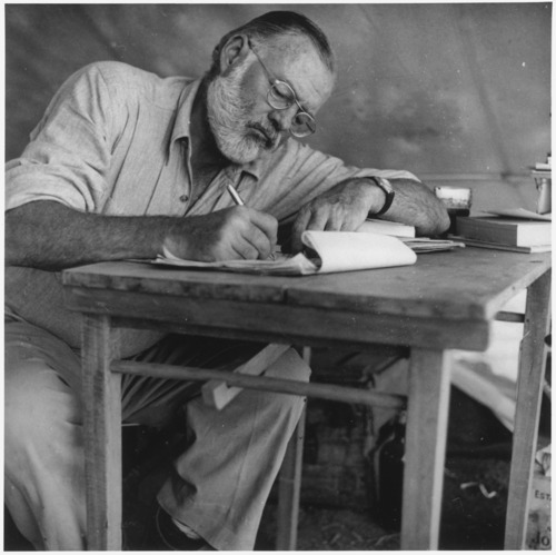Ernest_Hemingway_Writing_at_Campsite_in_Kenya_-_NARA_-_192655.jpg