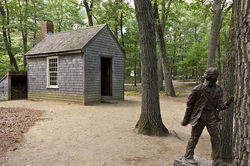 800px-Replica_of_Thoreau's_cabin_near_Walden_Pond_and_his_statue.jpg